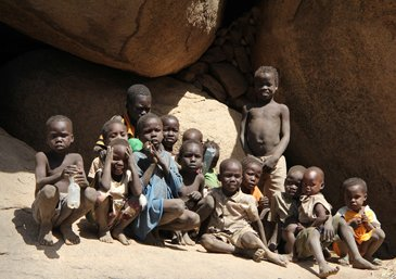 Because of the daily bombardments Nuba people live in the caves ...